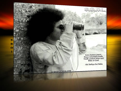 Sri -Sathya-Sai-Baba-with-binoculars (love-foster-peace...quote-wallpaper)